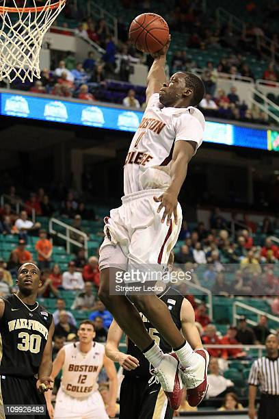 Reggie Jackson of the Boston College Eagles shoots against Travis McKie of the Wake Forest Demon Deacons during the second half of the game in the...