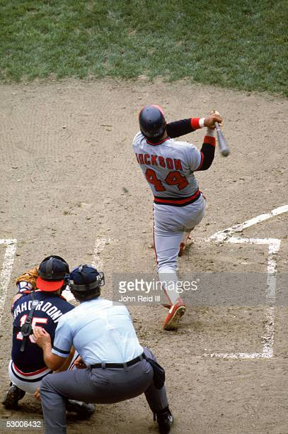 Reggie Jackson of the California Angels hits a home run during the game against the Cleveland Indians at Cleveland Stadium on July 17 1982 in...