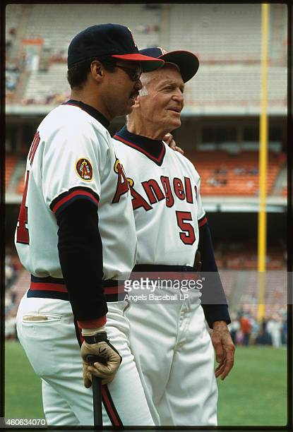 Reggie Jackson of the California Angels stands with coach Jimmie Reese at Anaheim Stadium circa 1980s in Anaheim California Reggie Jackson played...