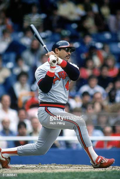 Reggie Jackson of the California Angels watches the flight of the ball as he follows through on a swing during a MLB season game circa 19831986