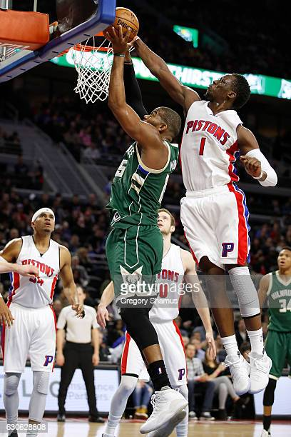 Reggie Jackson of the Detroit Pistons blocks the shot of Greg Monroe of the Milwaukee Bucks during the first half at the Palace of Auburn Hills on...