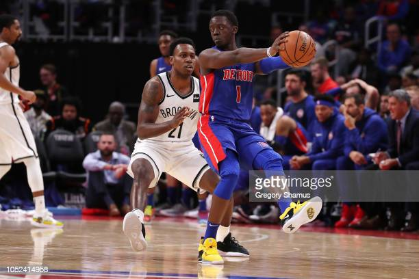 Reggie Jackson of the Detroit Pistons controls the ball in front of Treveon Graham of the Brooklyn Nets in the second half during the home opener at...