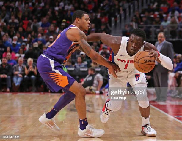 Reggie Jackson of the Detroit Pistons drives the ball to the basket as Tyler Ulis of the Phoenix Suns defends during the first quarter of the game at...