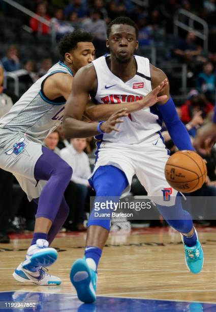 Reggie Jackson of the Detroit Pistons is guarded by Malik Monk of the Charlotte Hornets during the second half at Little Caesars Arena on February 10...