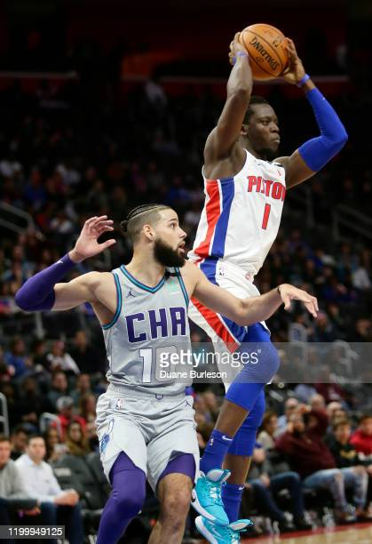 Reggie Jackson of the Detroit Pistons passes the ball against Caleb Martin of the Charlotte Hornets during the second half at Little Caesars Arena on...