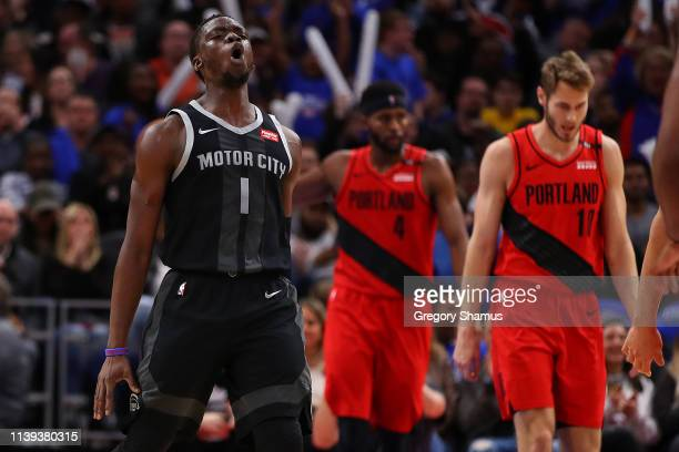 Reggie Jackson of the Detroit Pistons reacts after a second half dunk while playing the Portland Trail Blazers at Little Caesars Arena on March 30,...