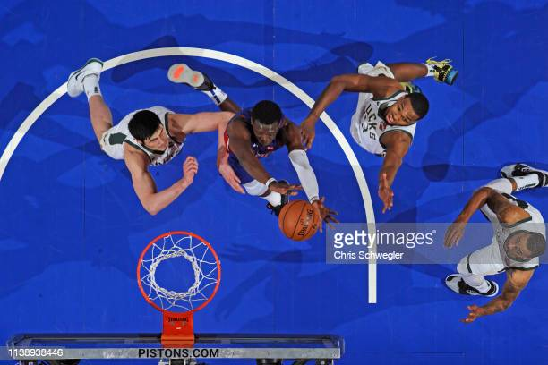Reggie Jackson of the Detroit Pistons rebounds the ball against the Milwaukee Bucks during Game Four of Round One of the 2019 NBA Playoffs on April...