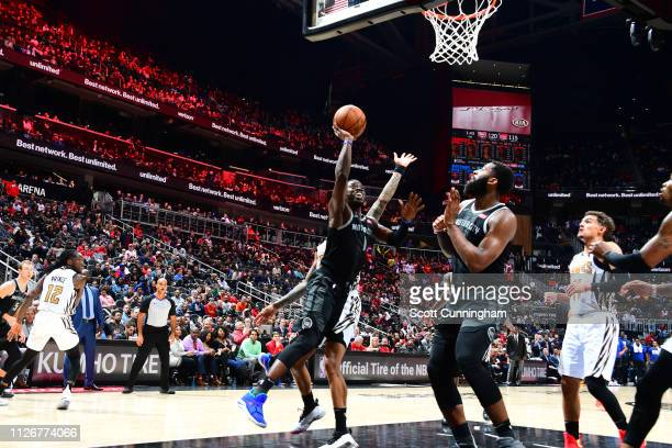Reggie Jackson of the Detroit Pistons shoots contested shot against the Atlanta Hawks on February 22 2019 at State Farm Arena in Atlanta Georgia NOTE...