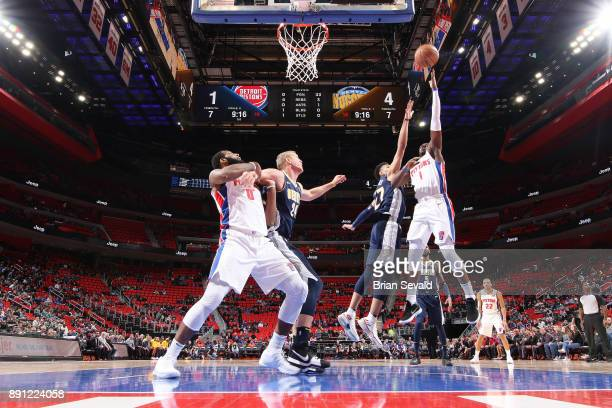 Reggie Jackson of the Detroit Pistons shoots the ball against the Denver Nuggets on December 12 2017 at Little Caesars Arena in Detroit Michigan NOTE...