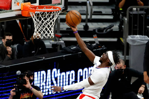 Reggie Jackson of the Los Angeles Clippers drives to the basket in the first half against the Phoenix Suns during game one of the Western Conference...