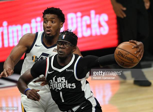 Reggie Jackson of the Los Angeles Clippers drives to the basket against Donovan Mitchell of the Utah Jazz during the second half in Game Six of the...
