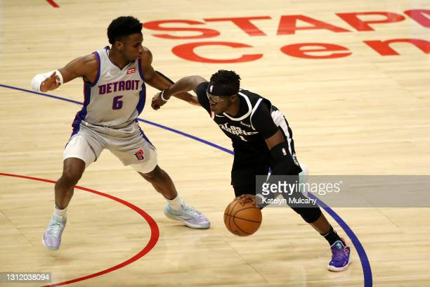 Reggie Jackson of the Los Angeles Clippers drives to the basket against Hamidou Diallo of the Detroit Pistons during the second quarter at Staples...