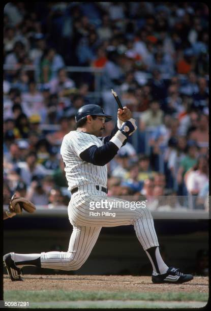 Reggie Jackson of the New York Yankees breaks his bat as he swings at a pitch during a game in 1980 at Yankee Stadium in Bronx New York