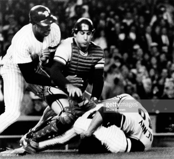 Reggie Jackson of the New York Yankees fights pitcher John Denny of the Cleveland Indians as Dave Winfield of the Yankees and catcher Ron Hassey of...
