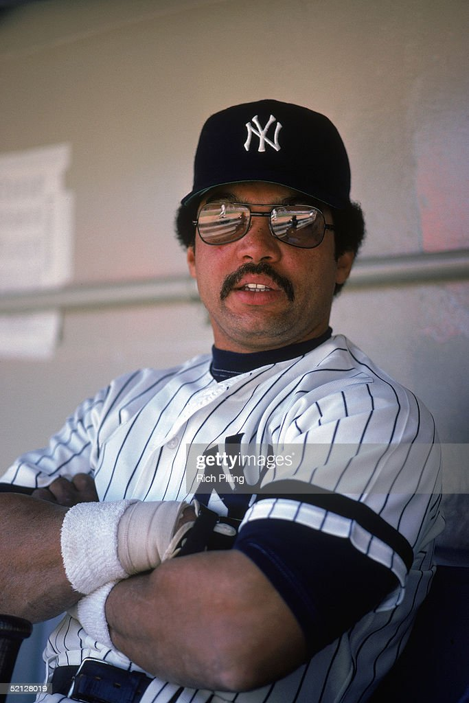 Reggie Jackson #44 of the New York Yankees poses for a portrait in the dugout. Reginald Martinez Jackson for the Yankees from 1977-81.