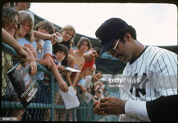 Reggie Jackson of the New York Yankees signs autographs for the fans in 1979