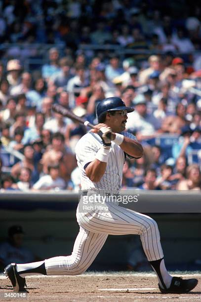Reggie Jackson of the New York Yankees swings at a pitch during a 1978 season game at Yankee Stadium in the Bronx New York