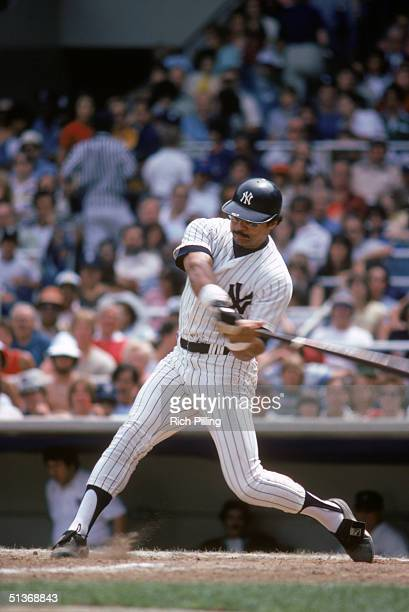 Reggie Jackson of the New York Yankees swings the bat during a game circa 19771981 at Yankee Stadium in Bronx New York