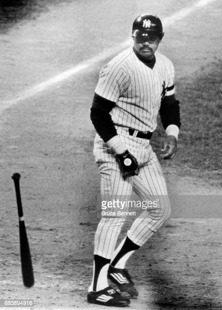 Reggie Jackson of the New York Yankees throws his bat after striking out during Game 3 of the 1980 American League Championship Series against the...