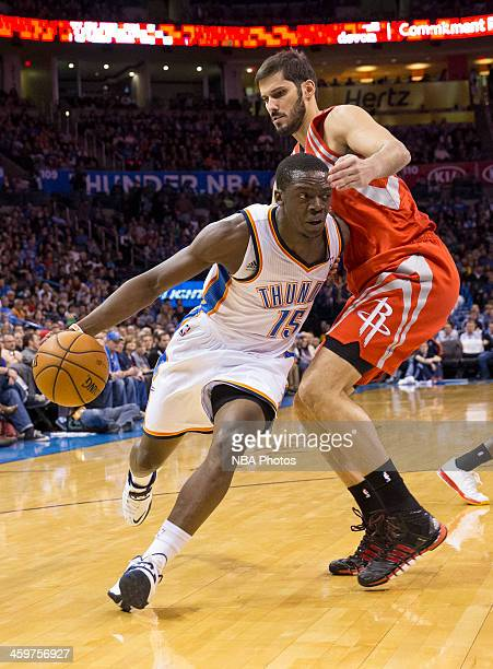 Reggie Jackson of the Oklahoma City Thunder handles the ball against Omri Casspi of the Houston Rockets at the Chesapeake Arena on December 29 2013...