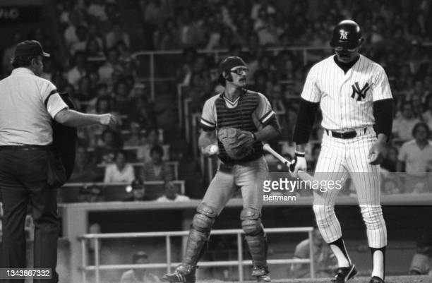 Reggie Jackson, the controversial $3 million slugger of the New York Yankees, fouls out while trying to bunt during the 10th inning during the game...