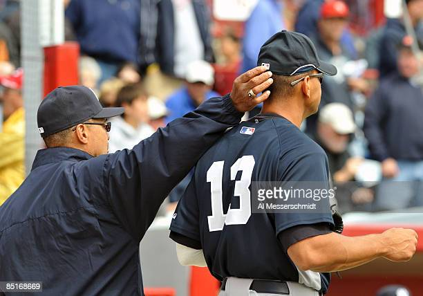 Reggie Jackson tips the cap of infielder Alex Rodriguez of the New York Yankees before play against the Cincinnati Reds March 1 2009 at Ed Smith...