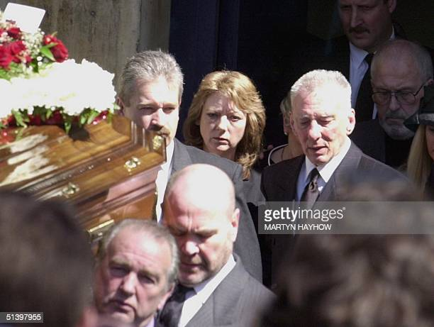 Reggie Kray aged 66 with his wife Roberta follow the coffin of his elder brother Charlie Wednesday April 19 as its leaves the church in Bethnal Green...