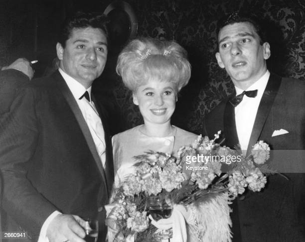 Reggie Kray right at a film premiere with actress Barbara Windsor and her husband Ronnie Knight an associate of the Kray Twins circa 1969