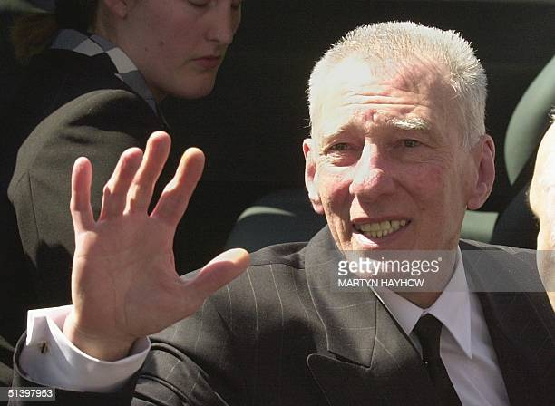 Reggie Kray waves to the crowds after attending the funeral of his elder brother Charlie 19 April 2000 as its leaves the church in Bethnal Green in...