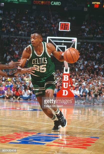 Reggie Lewis of the Boston Celtics dribbles the ball against the Detroit Pistons during an NBA basketball game circa 1991 at the The Palace of Auburn...