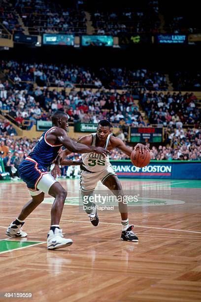 Reggie Lewis of the Boston Celtics drives against Anthony Mason of the New York Knicks during a game played at the Boston Garden in Boston,...