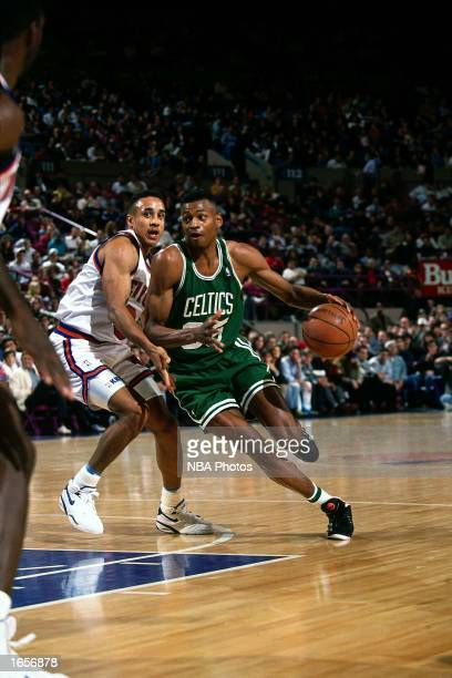 Reggie Lewis of the Boston Celtics drives to the basket during the 1990 NBA game against the New York Knicks at Madison Square Garden in New York New...
