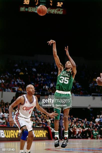 Reggie Lewis of the Boston Celtics shoots a jumpshot against the Los Angeles Clippers at the LA Sports Arena in Los Angeles California NOTE TO USER...