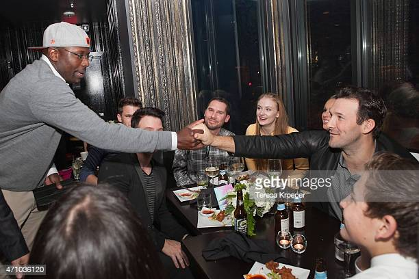 Reggie Love and Tony Romo attend The Evening Before a preWhite House Correspondents' Dinner party hosted by Eric Podwall and Spotify at Chaplin's...