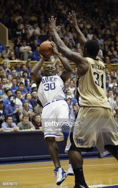 Reggie Love of the Duke Blue Devils attempts to shoot against Eric Williams of the Wake Forest Demon Deacons during the game at Cameron Indoor...