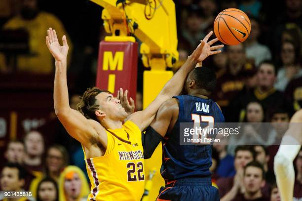 Reggie Lynch of the Minnesota Golden Gophers and Leron Black of the Illinois Fighting Illini go for a rebound during the game on January 3 2018 at...