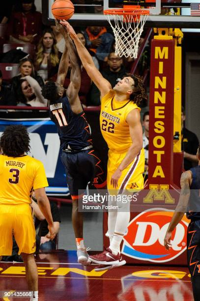 Reggie Lynch of the Minnesota Golden Gophers blocks a shot by Greg Eboigbodin of the Illinois Fighting Illini during the game on January 3 2018 at...