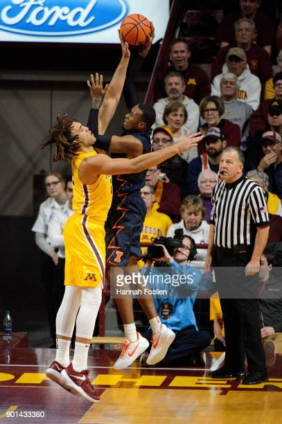 Reggie Lynch of the Minnesota Golden Gophers blocks a shot by Leron Black of the Illinois Fighting Illini during the game on January 3 2018 at...