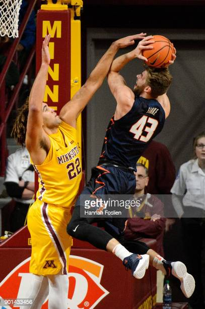 Reggie Lynch of the Minnesota Golden Gophers blocks a shot by Michael Finke of the Illinois Fighting Illini during the game on January 3 2018 at...