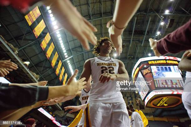 Reggie Lynch of the Minnesota Golden Gophers celebrates a win against the USC Upstate Spartans with fans after the game on November 10 2017 at...