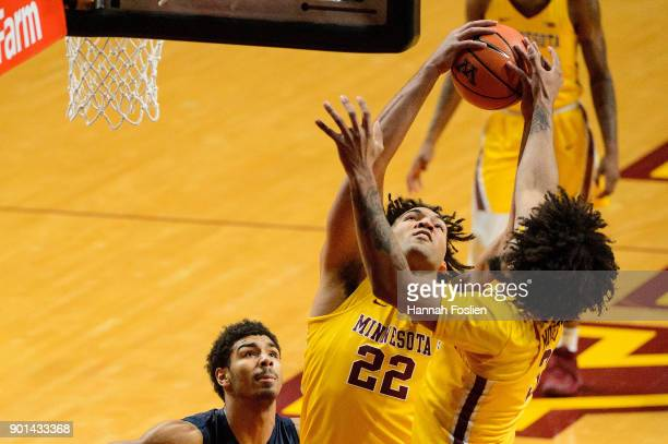 Reggie Lynch of the Minnesota Golden Gophers grabs a rebound against teammate Jordan Murphy during the game against the Illinois Fighting Illini on...