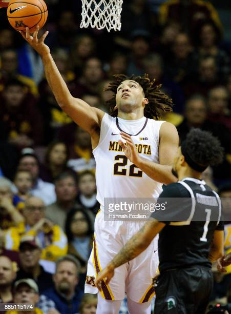 Reggie Lynch of the Minnesota Golden Gophers shoots the ball against Mike Cunningham of the USC Upstate Spartans during the game on November 10 2017...