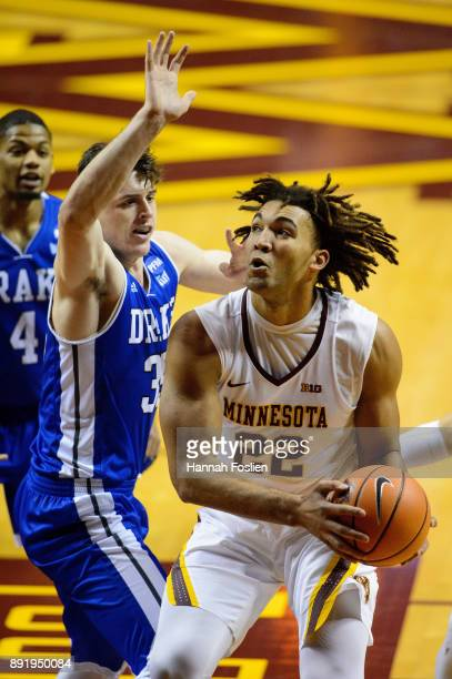 Reggie Lynch of the Minnesota Golden Gophers shoots the ball against Nick McGlynn of the Drake Bulldogs on December 11 2017 at Williams Arena in...