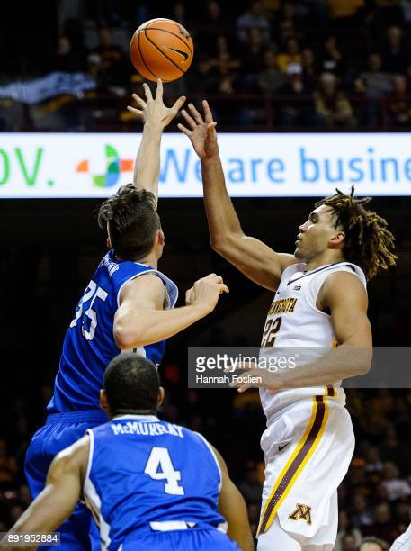 Reggie Lynch of the Minnesota Golden Gophers shoots the ball against Nick McGlynn of the Drake Bulldogs during the game on December 11 2017 at...