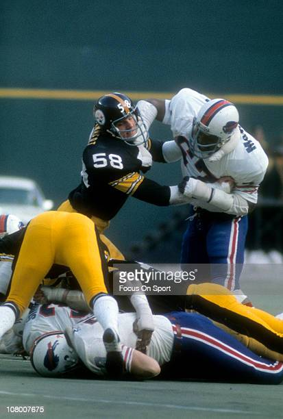 Reggie McKenzie in action against Jack Lambert of the Pittsburgh Steelers during an NFL football game at Three Rivers Stadium December 22 1974 in...
