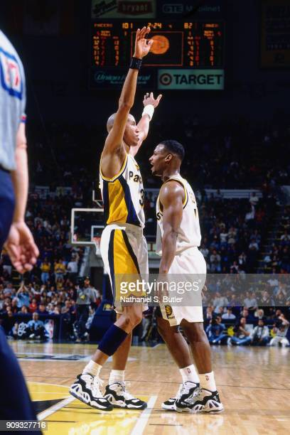 Reggie Miller and Travis Best of the Indiana Pacers celebrate during a game played on March 2 1997 at Market Square Garden in Indianapolis Indiana...