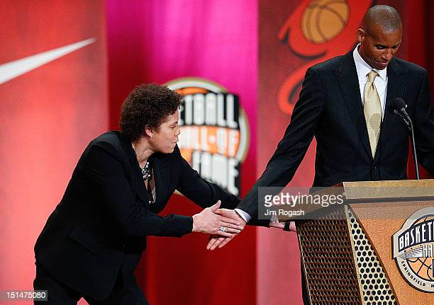 Reggie Miller is given a playful tap on the rear by sister Cheryl Miller during the Basketball Hall of Fame Enshrinement Ceremony at Symphony Hall on...