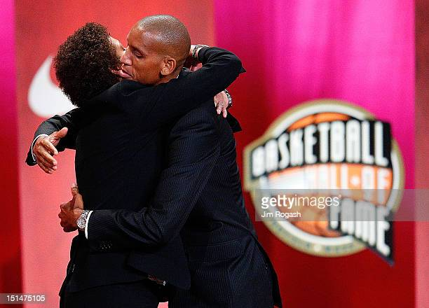 Reggie Miller is hugged by his sister Cheryl Miller during the Basketball Hall of Fame Enshrinement Ceremony at Symphony Hall on September 7 2012 in...