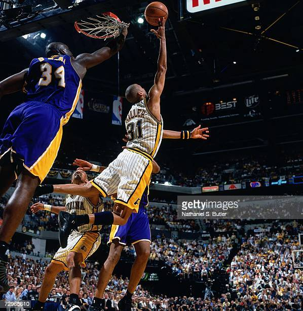 Reggie Miller of the Indiana Pacers attempts a layup against Shaquille O'Neal of the Los Angeles Lakers during Game Five of the 2000 NBA Finals on...
