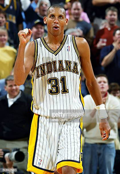 Reggie Miller of the Indiana Pacers celebrates the 9483 victory over the Miami Heat during Game five of the Eastern Conference Semifinals of the 2004...